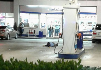 Tackling Gas Station Employee shot to death during armed robbery.