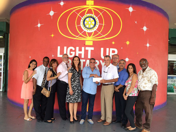 Le Grand Marche Donates 10,000 Guilders For Rotary Youth Scholarship Programs.